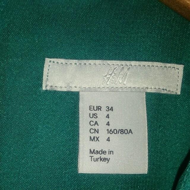 H&M(エイチアンドエム)のH&M ワンピース(グリーン) レディースのワンピース(ひざ丈ワンピース)の商品写真