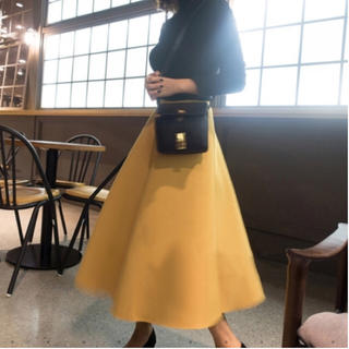 ルシェルブルー(LE CIEL BLEU)のAラインボンディングスカート イエロー(ひざ丈スカート)