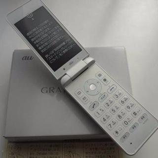 キョウセラ(京セラ)の新品 au GRATINA 4G KYF31 ホワイト SIMフリー可能(携帯電話本体)