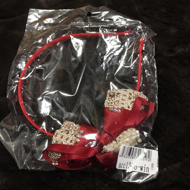 カチューシャ 赤 リボン レディースのヘアアクセサリー(カチューシャ)の商品写真