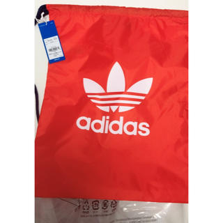アディダス(adidas)のアディダス ナップサック オレンジカラー(リュック/バックパック)