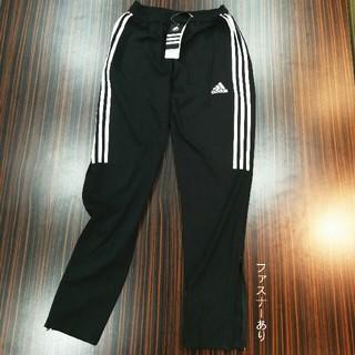 アディダス(adidas)のアディダス ファスナー裾口 ロゴプリント 長パンツ M/Lサイズ 黒色(チノパン)