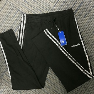 アディダス(adidas)の文字ストライプアディダス adidas  長ズボン M/L2サイズ 黒色(チノパン)