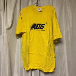 エーディージー(A.D.G)のA.D.Gモーションロゴ イエローTシャツ(Tシャツ(半袖/袖なし))