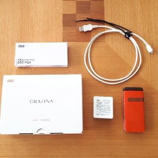 キョウセラ(京セラ)のau GRATINA オレンジ 充電池ケーブル 箱なし (携帯電話本体)