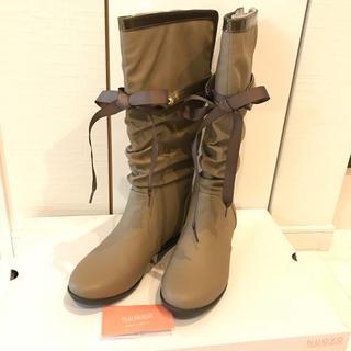 ヌォーボ(Nuovo)の【美品☆送料込】NUOVOレインブーツ  Lサイズ 取り外せるリボンベルト付き(レインブーツ/長靴)