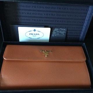 プラダ(PRADA)のPRADA プラダ 長財布 オレンジ(財布)
