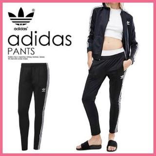 アディダス(adidas)のadidas originals スキニーパンツ ブラック×ホワイト(スキニーパンツ)