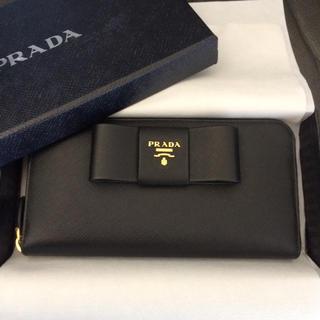 プラダ(PRADA)の新品未使用 プラダ ラウンドジップ リボン長財布 レザー ブラック黒バッグ折ミニ(財布)