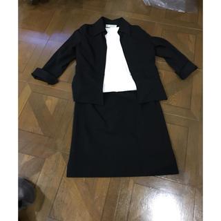 22オクトーブル   黒スーツ