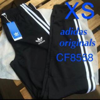 アディダス(adidas)の最安 adidas sst cuffed track pants(その他)