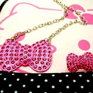 サンリオ(サンリオ)のハローキティ ピンクラインストーンリボン型ネックレス&リング(ネックレス)