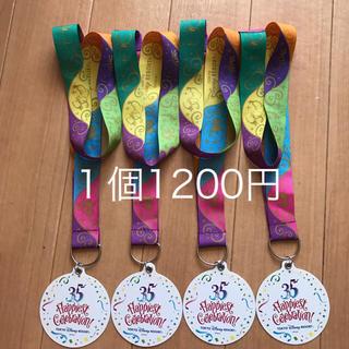 ディズニー(Disney)の【送料込】ディズニー 35周年 メダル ハピエストサプライズ(ノベルティグッズ)