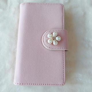 シマムラ(しまむら)のスマートフォンケース iPhone6、6S手帳型 ピンク パール 新品未使用(iPhoneケース)