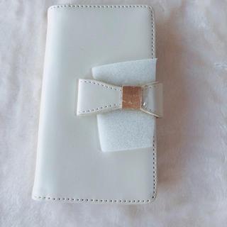 シマムラ(しまむら)のスマートフォンケース iPhone6、6S 手帳型 ホワイト リボン(iPhoneケース)