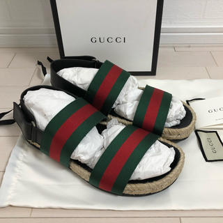 グッチ(Gucci)の【新品未使用】6(25.5) グッチ ロゴ フラット サンダル 日本未入荷(サンダル)