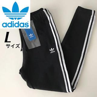 アディダス(adidas)の【定価8629円】adidas スキニーパンツ トラックパンツ 黒 Lサイズ(スキニーパンツ)