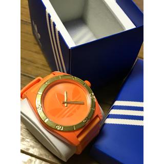 アディダス(adidas)のadidasオリジナル 腕時計 ネオンオレンジ(腕時計(デジタル))