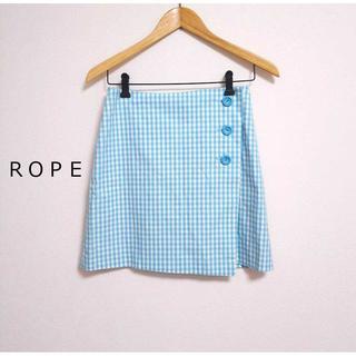 ロペ(ROPE)のロペ★ギンガムチェック柄ラップスカート 水色  巻きスカート ブレッピー(ミニスカート)