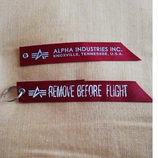 アルファ(alpha)のALPHA赤リボン(ミリタリージャケット)