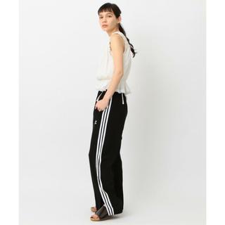 アディダス(adidas)のadidas ×Another editionトラックパンツ(カジュアルパンツ)