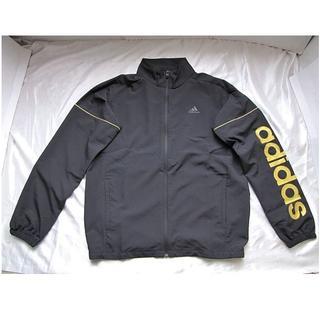アディダス(adidas)の新品★アディダス ビッグロゴ クロスジャケット/黒金(Oサイズ)★送料込み!(ナイロンジャケット)