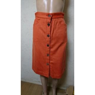 デザインワークス(DESIGNWORKS)のDESIGN worksオレンジスカート。(ひざ丈スカート)