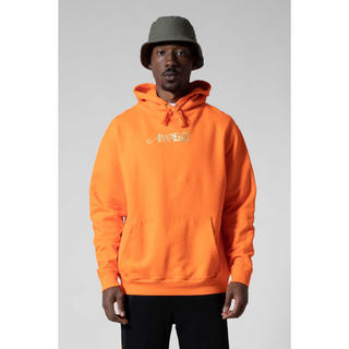 アウェイク(AWAKE)のAwake NY METALLICFOIL LOGO HOODIE Orange(パーカー)