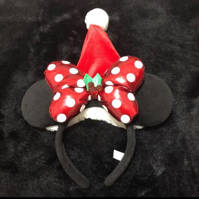 Disney(ディズニー)の美品ディズニークリスマスミニーマウス水玉リボンサンタクロース帽子付きカチューシャ エンタメ/ホビーのおもちゃ/ぬいぐるみ(キャラクターグッズ)の商品写真