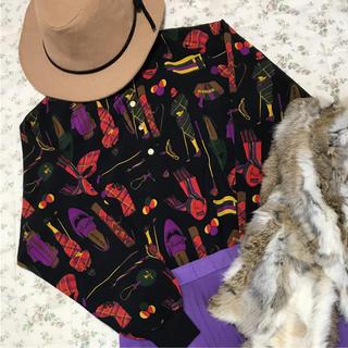 マンシングウェア(Munsingwear)のMUNSINGWEAR レトロ柄 ポロシャツ(ポロシャツ)