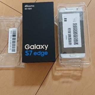 サムスン(SAMSUNG)のdocomo GALAXY S7EDGE 新品 ホワイト(スマートフォン本体)