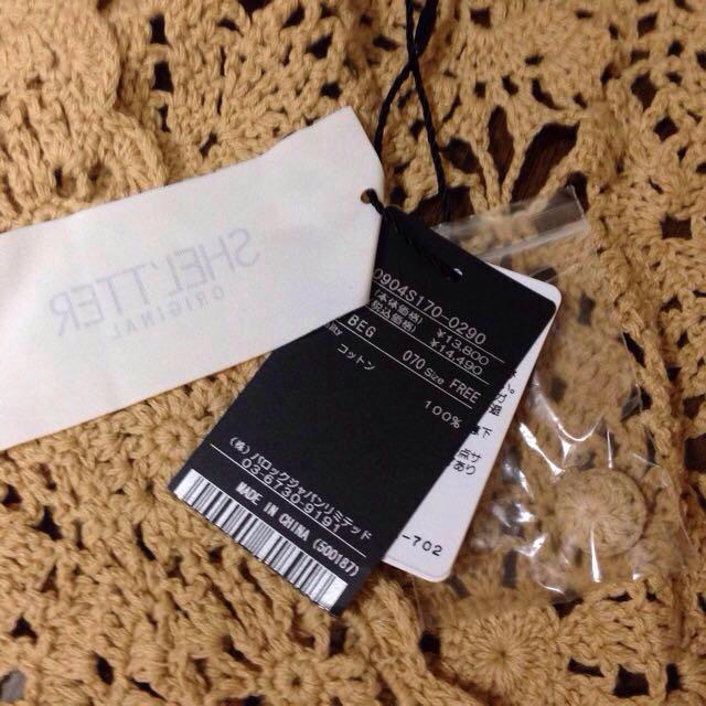 シェルター 新品 かぎ針 ポンチョ レディースのジャケット/アウター(ポンチョ)の商品写真