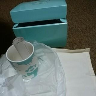 ディズニー(Disney)の新品未使用ディズニーマグカップ水色ランチョンマット付(テーブル用品)