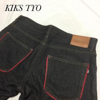 キックスティーワイオー(KIKS TYO)のKIKS TYO キックスティーワイオー 黒 レッドループ サイズL約82cm(デニム/ジーンズ)