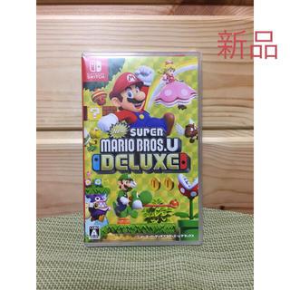 ニンテンドースイッチ(Nintendo Switch)の【新品、送料無料】New スーパーマリオブラザーズ U デラックス マリオ(家庭用ゲームソフト)