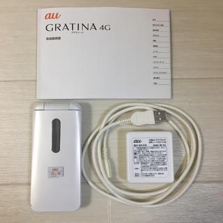 エーユー(au)のGRATINA 4G KYF31 白  au ガラホ(携帯電話本体)