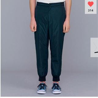 ジーユー(GU)の完売新品未使用 GU×KIM JONES 中綿ジョガーパンツ 紺 ネイビー S(その他)
