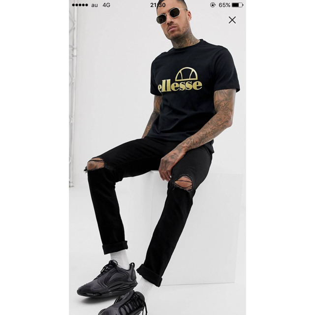 ellesse(エレッセ)のELLESSE(エレッセ)ブラック ゴールド ロゴ T シャツ メンズのトップス(Tシャツ/カットソー(半袖/袖なし))の商品写真