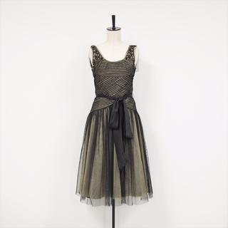 ビーシービージーマックスアズリア(BCBGMAXAZRIA)のオープンバック BK×GD ビジュー付きドレス(ミディアムドレス)