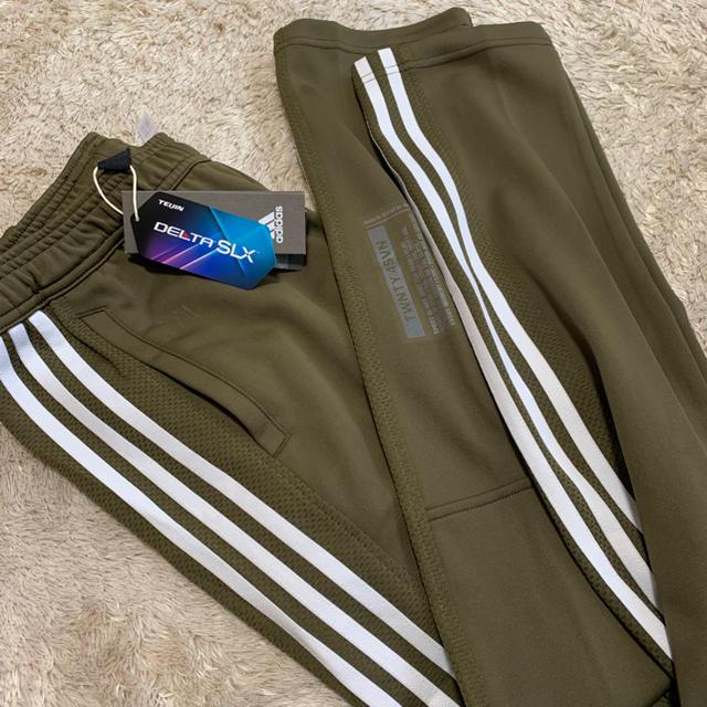 adidas(アディダス)の【即完売品】新品 adidas カーキ色 ジャージ トラックパンツ メンズのパンツ(その他)の商品写真