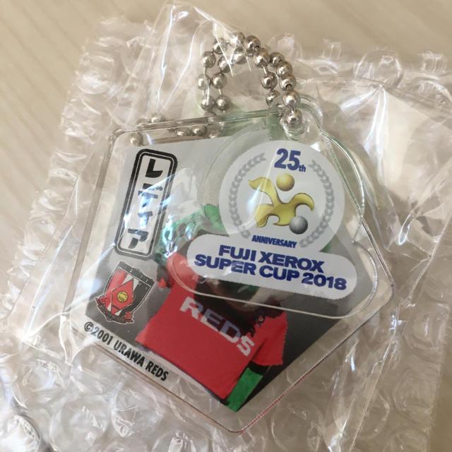 NIKE(ナイキ)の2019 浦和レッズ ACL用 ユニフォーム 未開封 +おまけ スポーツ/アウトドアのサッカー/フットサル(応援グッズ)の商品写真