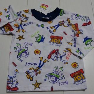 トイストーリー(トイ・ストーリー)の新品タグ付きトイストーリー総柄ロングTシャツ80センチロンT(Tシャツ)