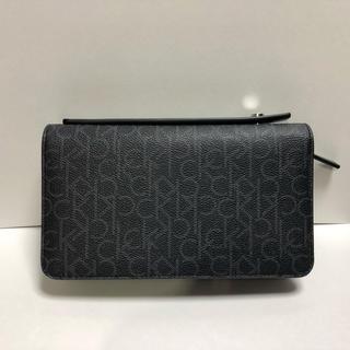カルバンクライン(Calvin Klein)のカルバンクライン 持ち手付き ラウンドジップ 長財布兼セカンドバック(セカンドバッグ/クラッチバッグ)