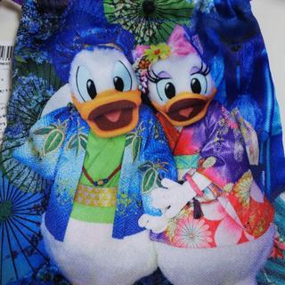 ディズニー(Disney)のイマジニングザマジックドナルドデイジー巾着袋(小物入れ)