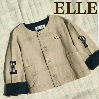 エル(ELLE)のオシャレな配色 ノーカラージャケット 長袖 ベージュ ネイビー紺 刺繍 ワッペン(ジャケット/上着)