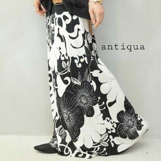 アンティカ(antiqua)のわかさん2way花柄スカート・裾タックトップス黒(ロングスカート)