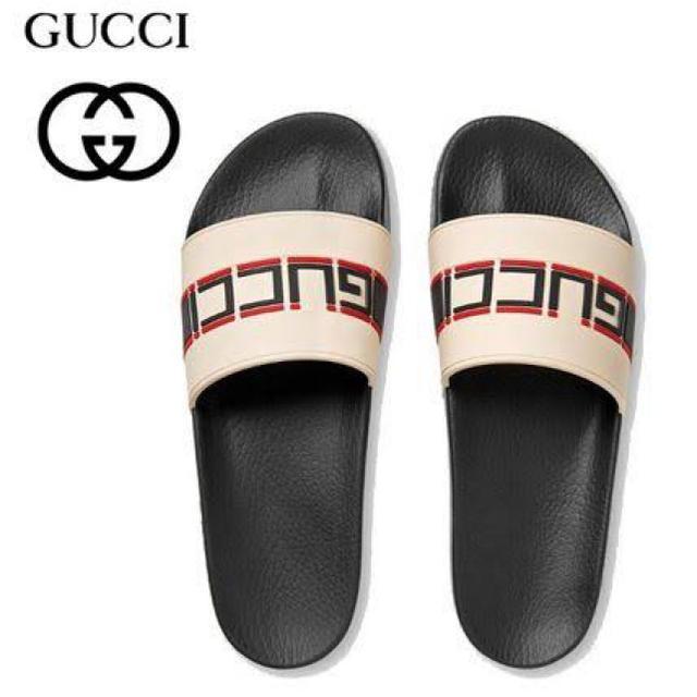 332230fadd8b Gucci(グッチ)のGUCCI グッチ ストライプ ラバー スライド ロゴ サンダル 【国内正規品