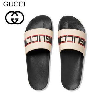 グッチ(Gucci)のGUCCI グッチ ストライプ ラバー スライド ロゴ サンダル 【国内正規品】(サンダル)