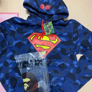 アベイシングエイプ(A BATHING APE)の激安XLサイズ新品! BAPE×DCカラーカモ supermanパーカー青迷彩(パーカー)