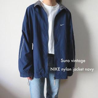 ナイキ(NIKE)のNIKE 刺繍ロゴ ナイロンジャケット ネイビー ブルー 古着 レディース(ナイロンジャケット)